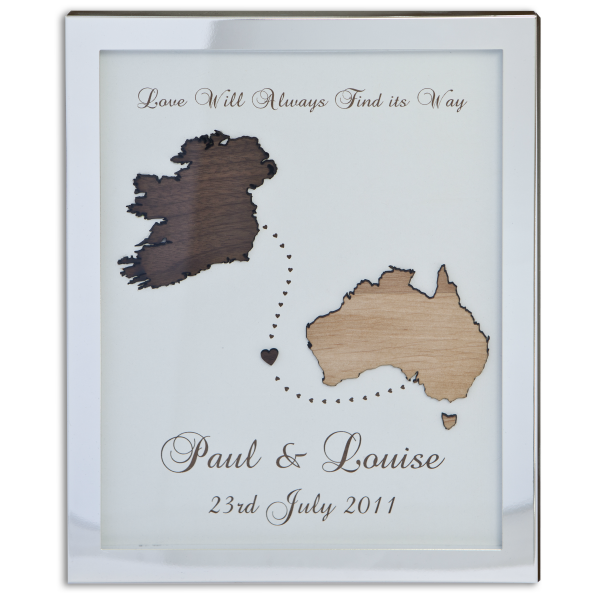 "Love Will Always Find its Way, Personalised engagement frame, personalised engagement gift Ireland, a silver frame with a back insert engraved with ""Love will always find its way, Paul & Louise 23rd July 2011"" with 2 wooden cut outs of Ireland and Australia."