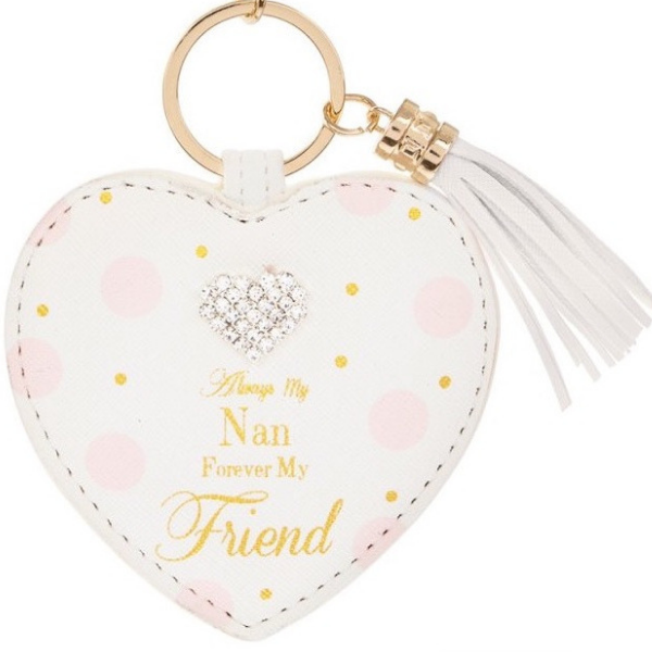 "Always My Nan Forever My Friend Keyring,mother's day gifts, mother's day 2019, always my Mum gifts, Mother's day gifts Ireland, A white heart shaped keyring with pink and gold dots and a diamonte heart embellishment gem at the top. On a gold keyring and has a tassle hanging to the side. It reads ""Always my nan forever my friend"" in gold writing."