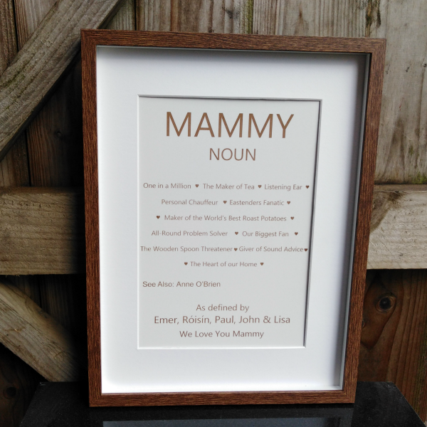 "Definition of Mammy, Mother's Day Gift, Birthday Gift, Thank you Gift, A brown wooden frame with a white mount holding a laser engraved white backboard that reads ""Mammy Noun""followed by a list of definitions personalised. Personalisd gifts Ireland by Precision Designs"